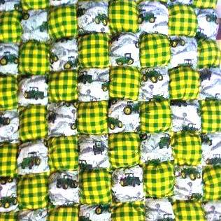John Deere puff quilt with yellow and black plaid.