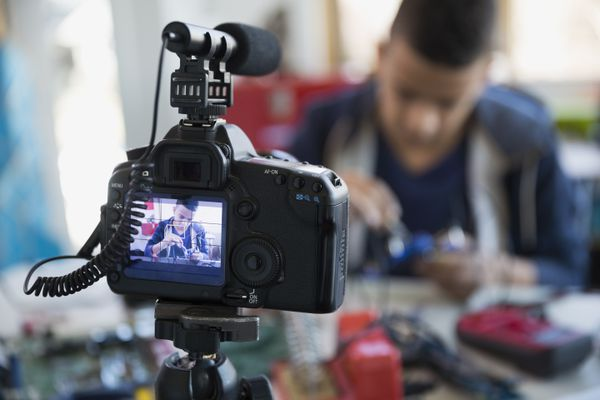 Close up camera and microphone video taping boy