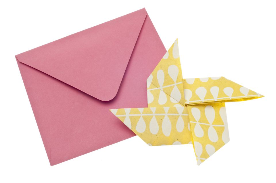 Yellow patterned origami pinwheel with pink envelope