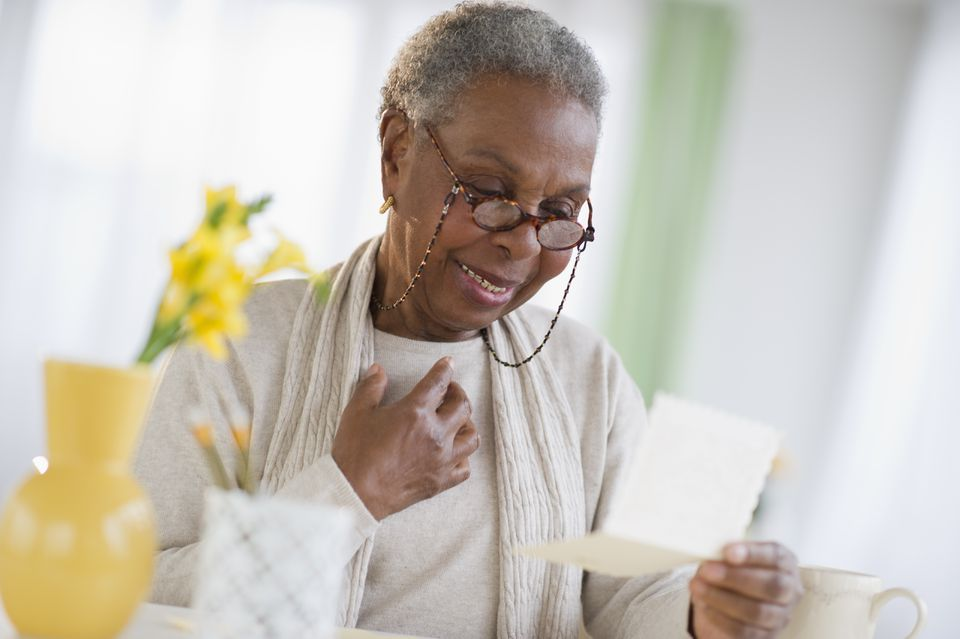 Older woman reading letter