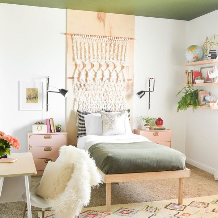 A boho inspired bedroom with a platform bed
