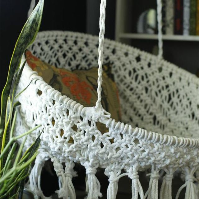 A hanging macrame chair