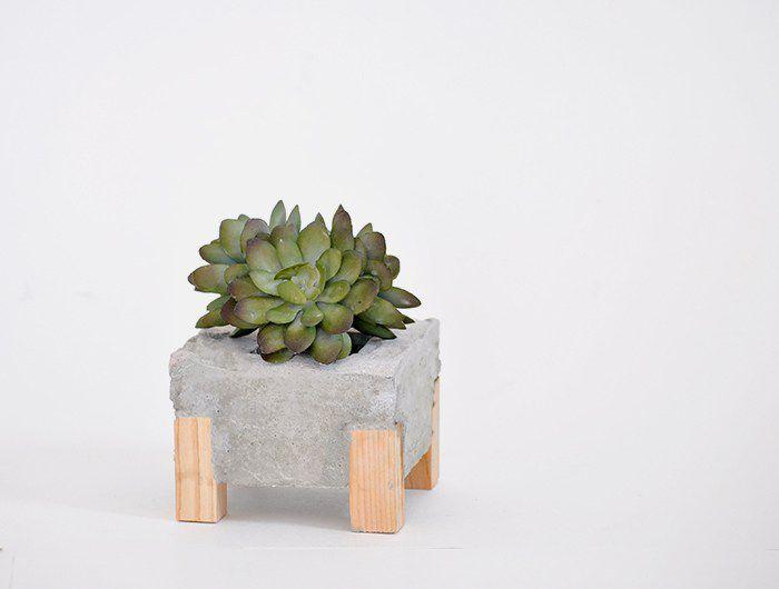 wooden leg concrete planter