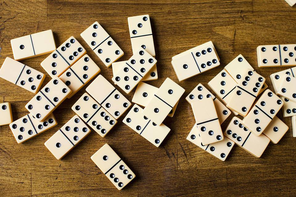 dominoes spread on table