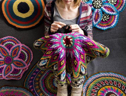 woman crocheting on the floor