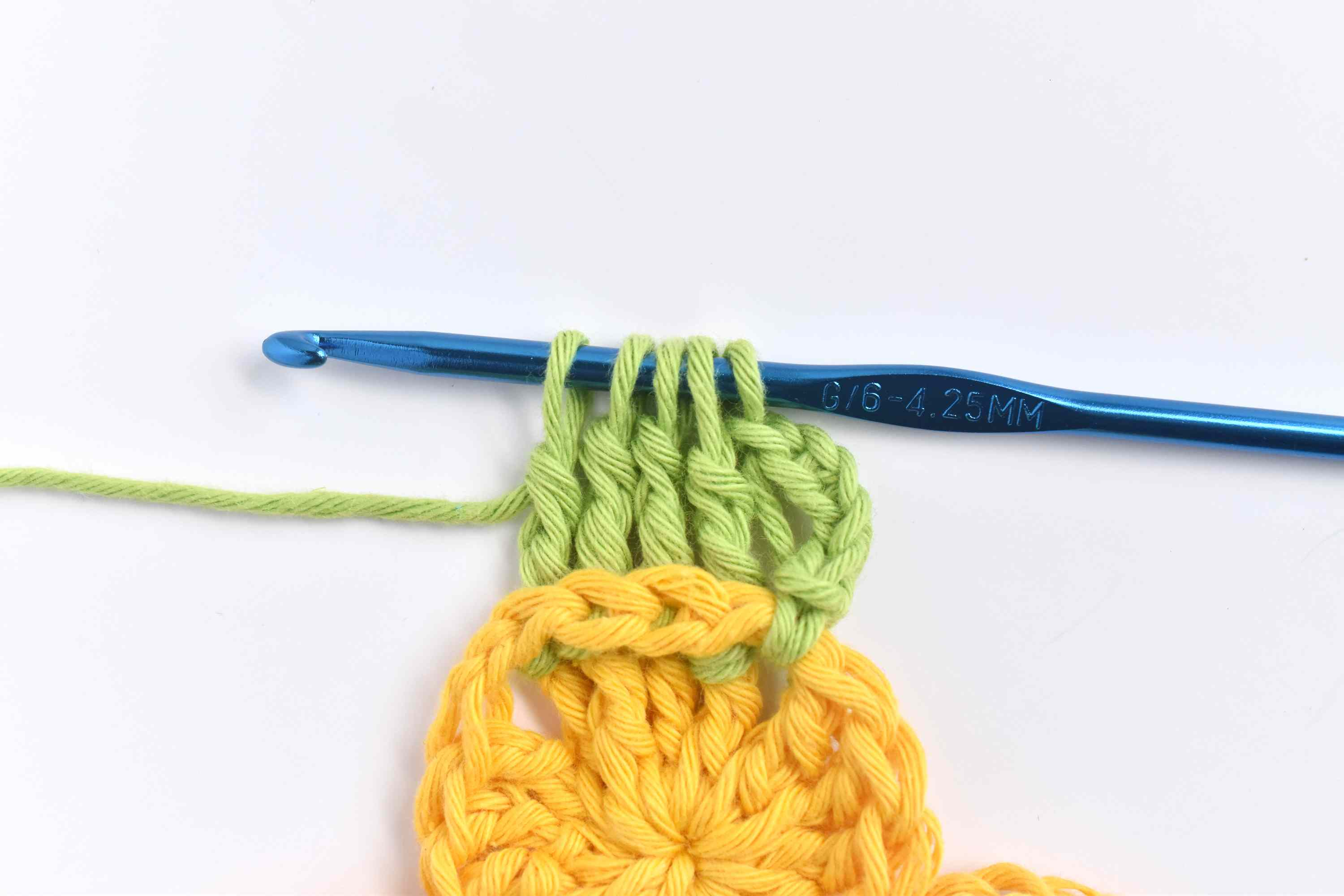 With Five Loops on the Hook, Yarn Over and Draw Through