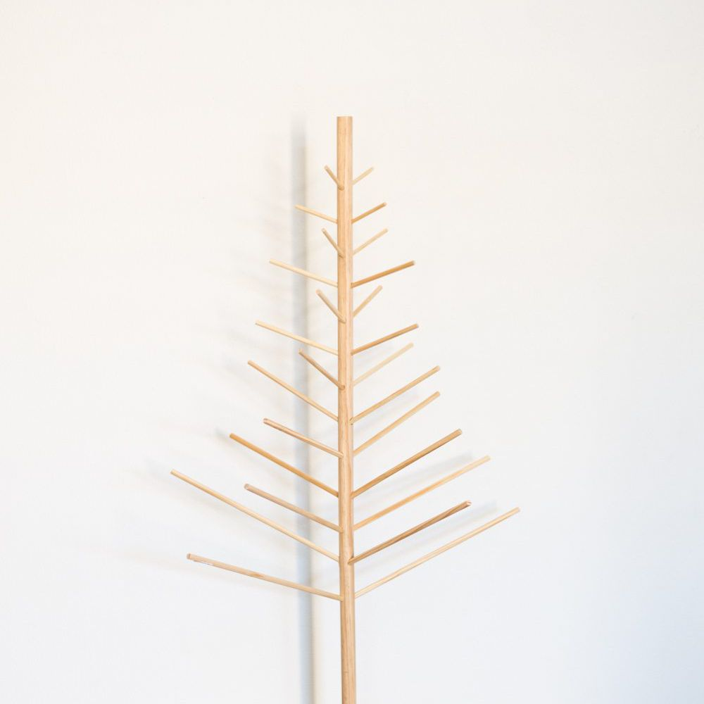 A minimal Christmas tree frame made from wooden dowels.