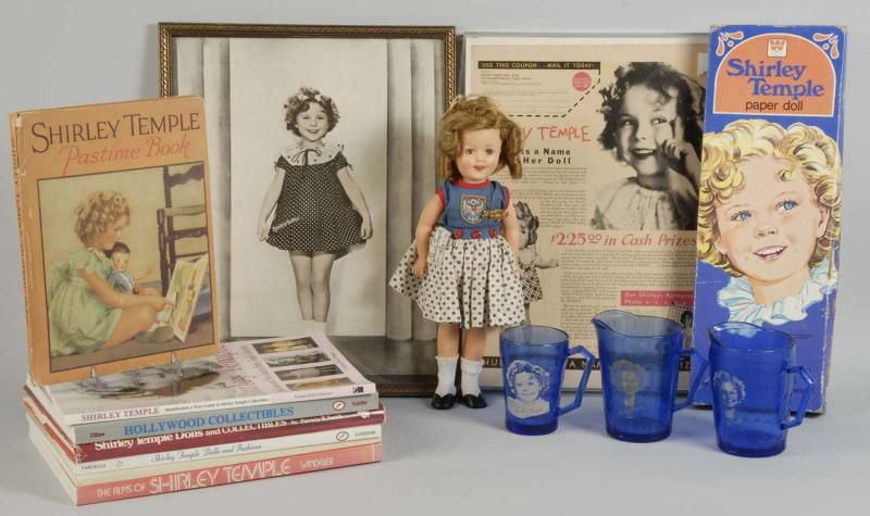 An array of Shirley Temple memorabilia including a doll and glassware