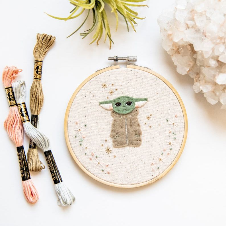 Baby Yoda made in felt in an embroidery hoop
