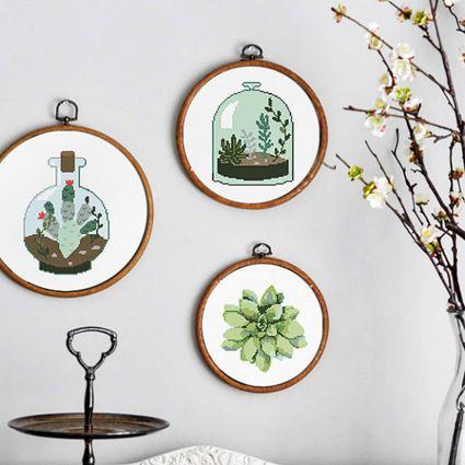 Three different cactus cross-stitch patterns