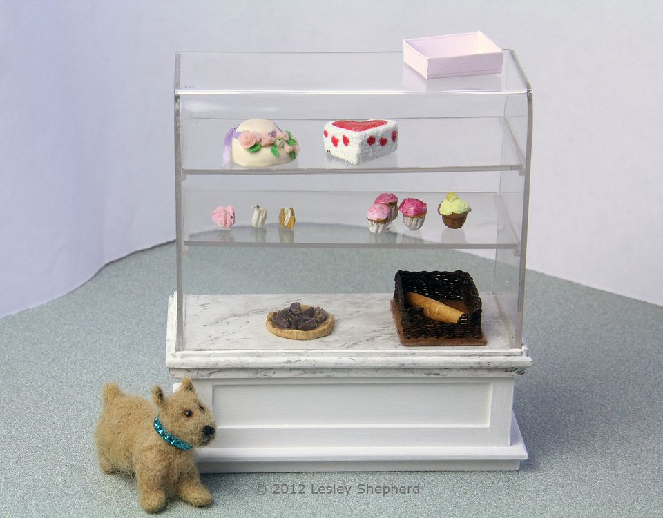 Glass topped pastry case in dollhouse scale.