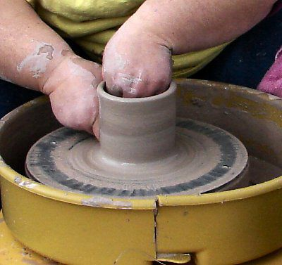 Beginning the throw on the potter's wheel