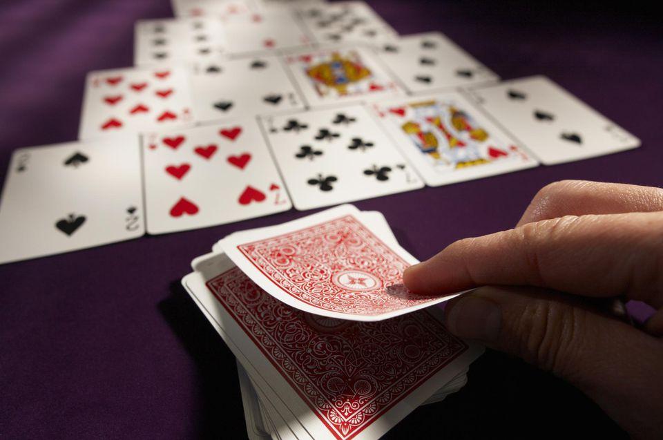 Man playing a card.