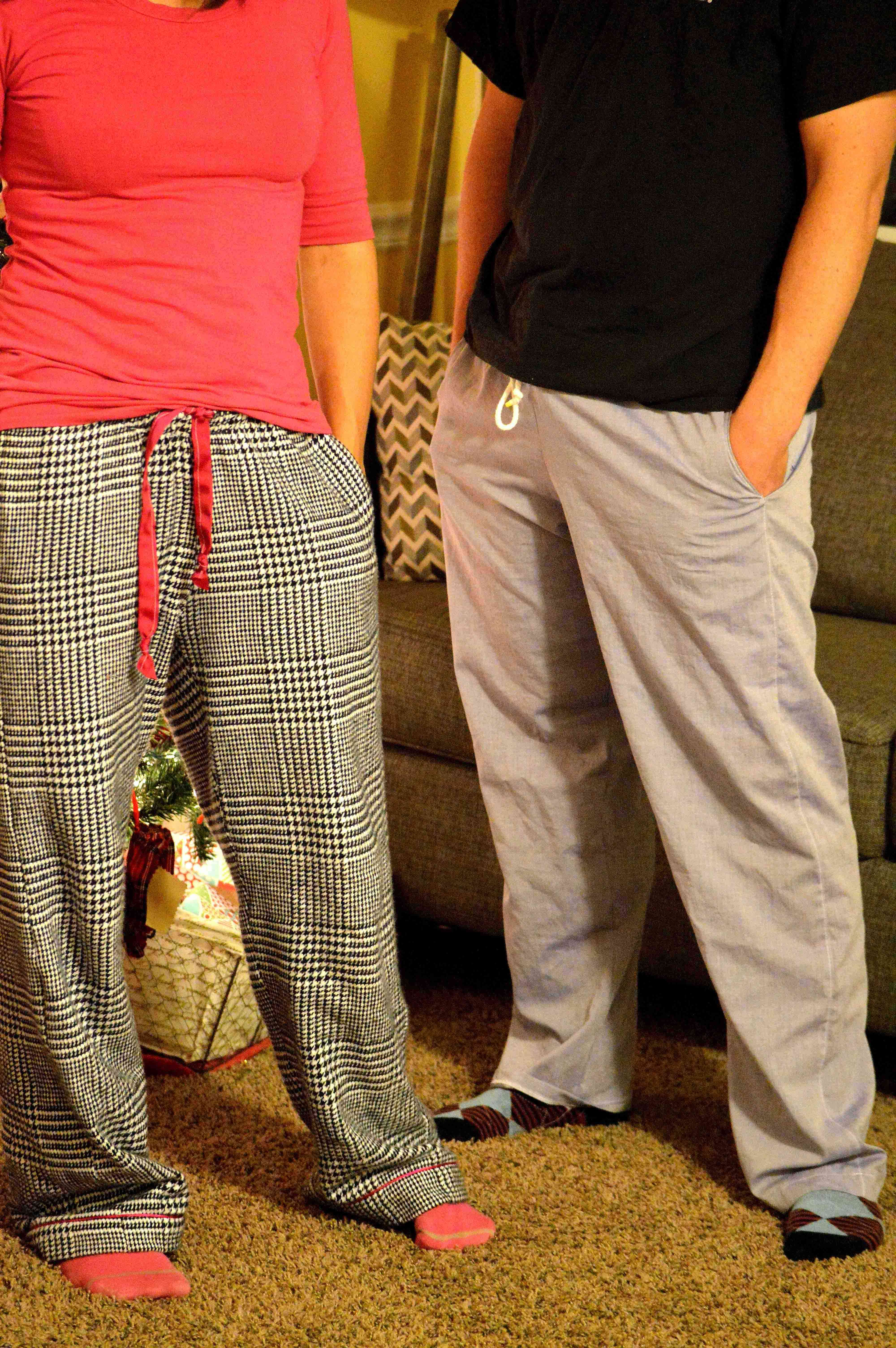 A man and woman wearing pajama pants