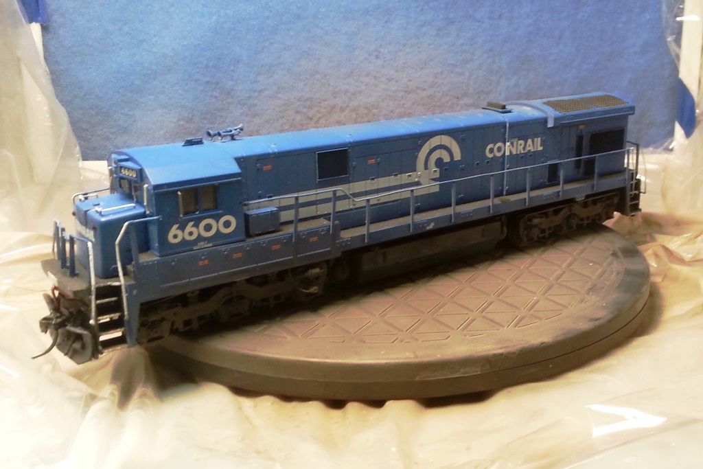 weathering decals on a model train.