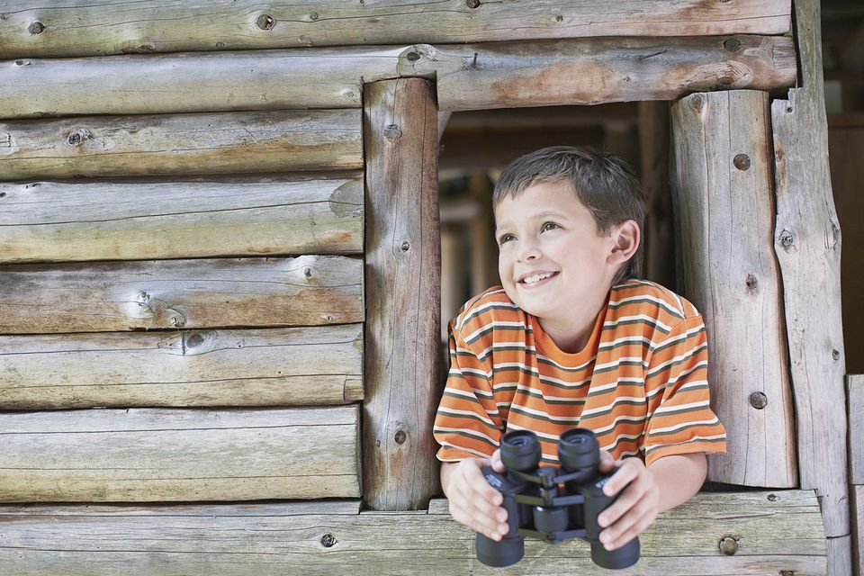 Boy in Wooden Playhouse Holding Binoculars