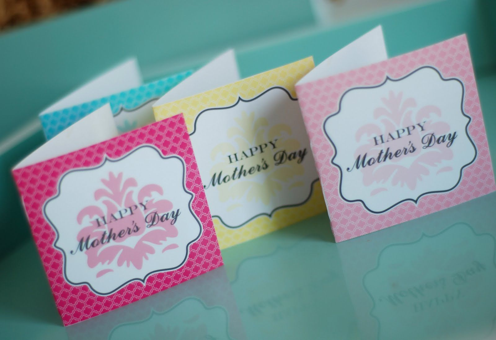 Colorful miniature Mother's Day cards on a table