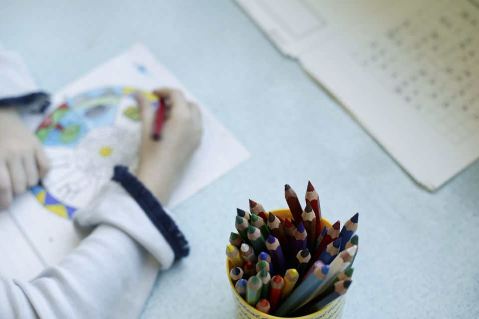 Child painting, close-up crayons