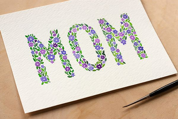 A hand-painted Mother's Day card that says