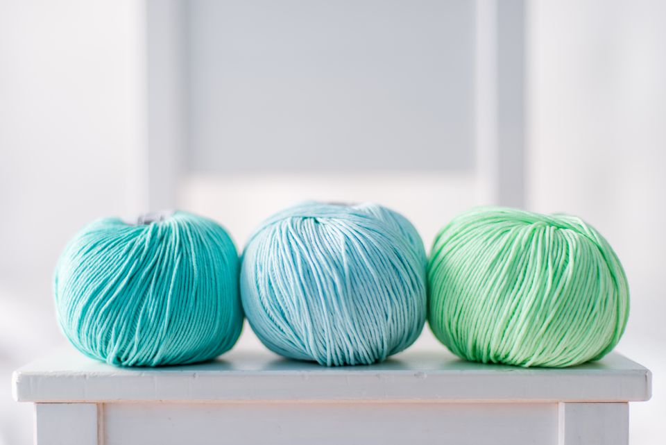 Three green yarn balls