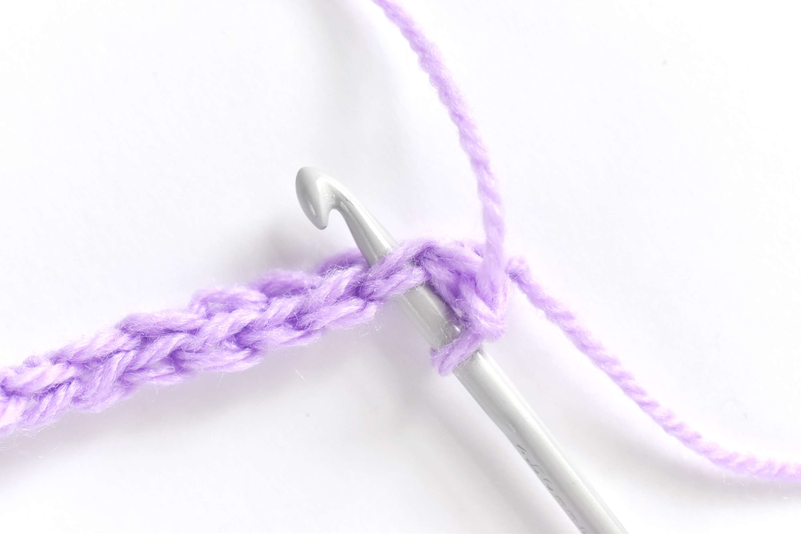 Inserting the Hook Through Both Loops of a Crochet Stitch