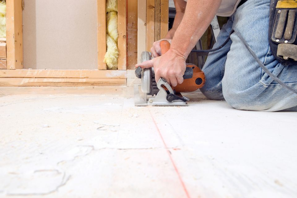 Circular Saw Cutting Subfloor for House Remodeling Project
