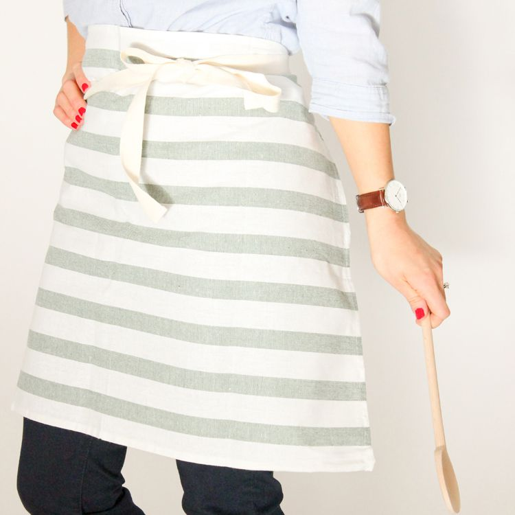 A woman wearing a gray and white striped apron