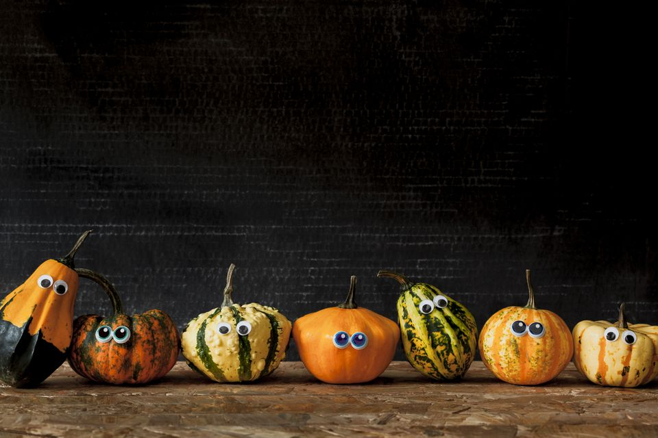 Seven pumpkins with eyes in a row for Halloween