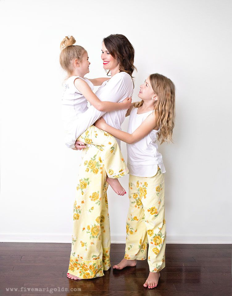 A family wearing matching pajama pants