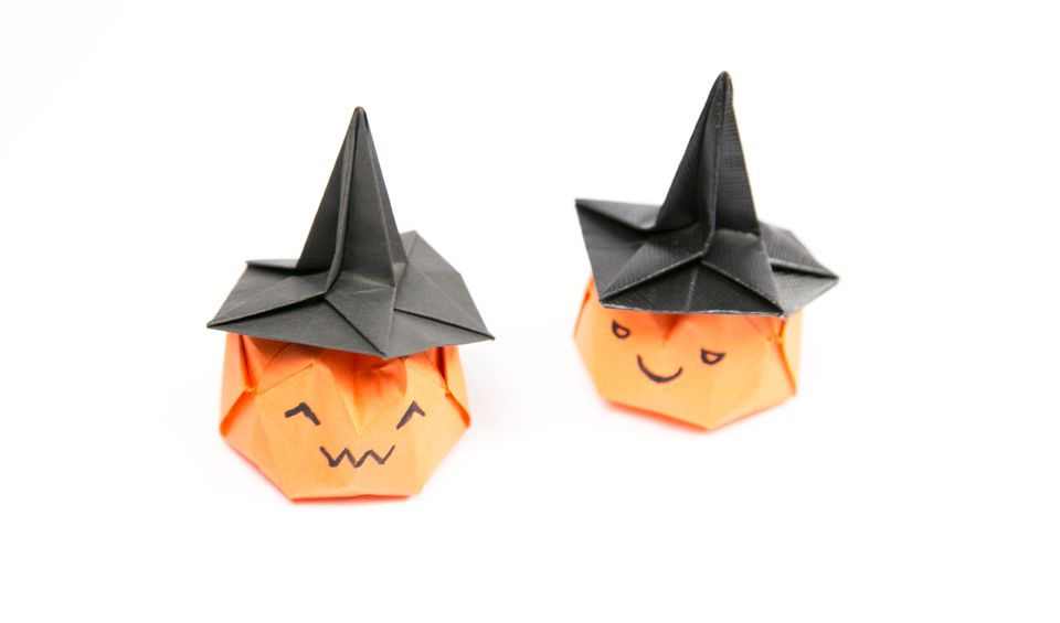 origami witches hat on pumpkin