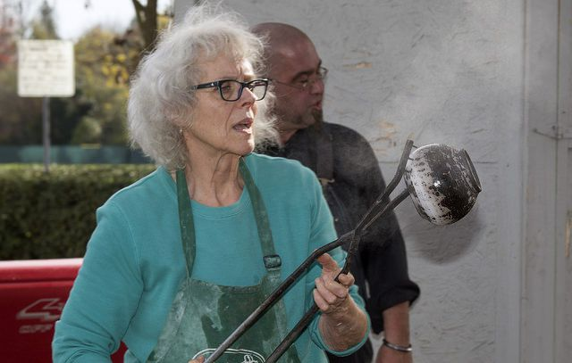 Mary Cargile working her Obvara pots during Raku pottery firing at El Camino Fundamental High School, Sacramento, Calif., Nov. 6, 2014.