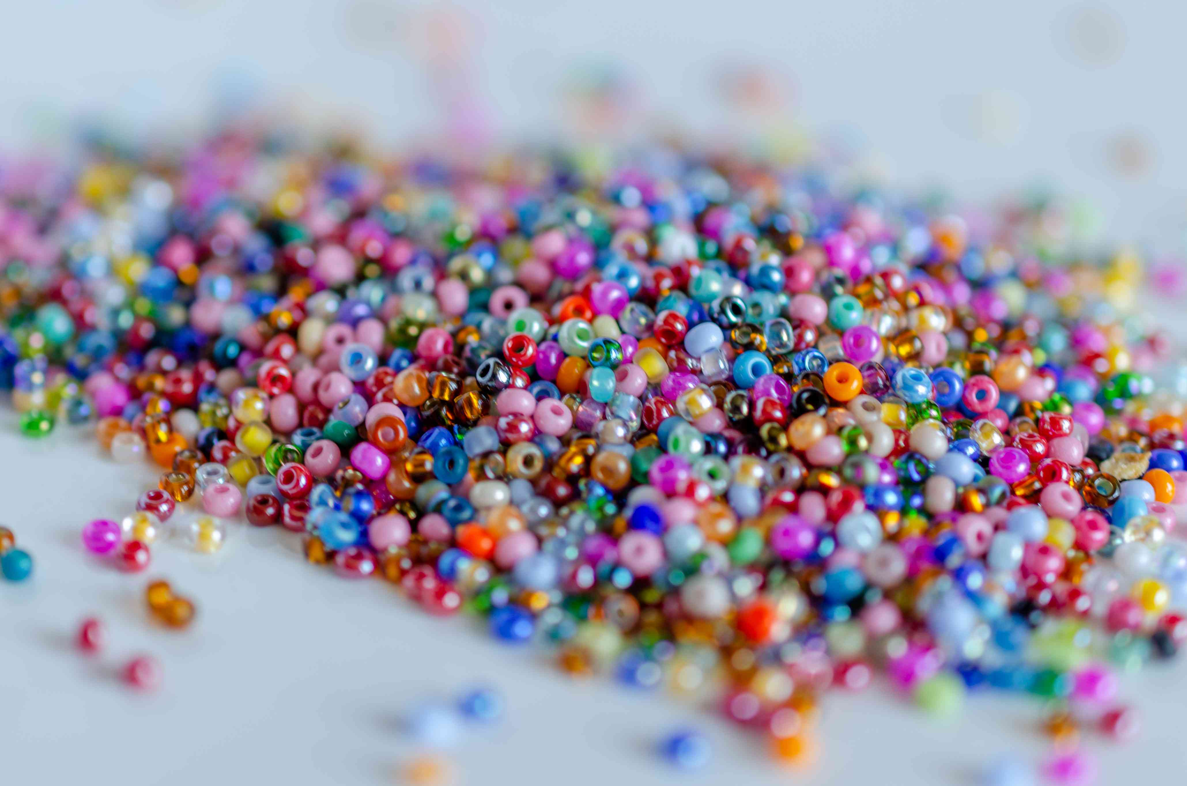 Mix of colorful seed beads, texture background