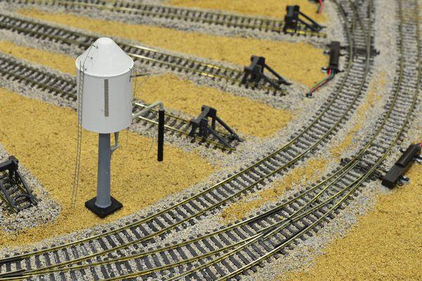 Model of a water tower on a model railway desert landscape
