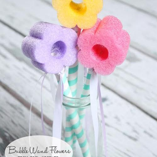 Pool noodle flowers in red, purple, and yellow in a Mason jar.