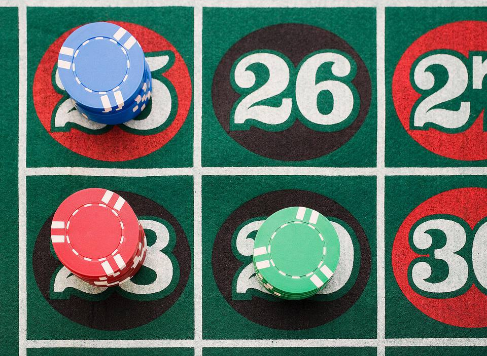 Poker chips on Roulette table