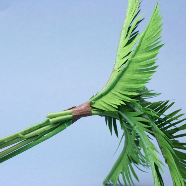 Miniature wired palm fronds grouped together and wrapped