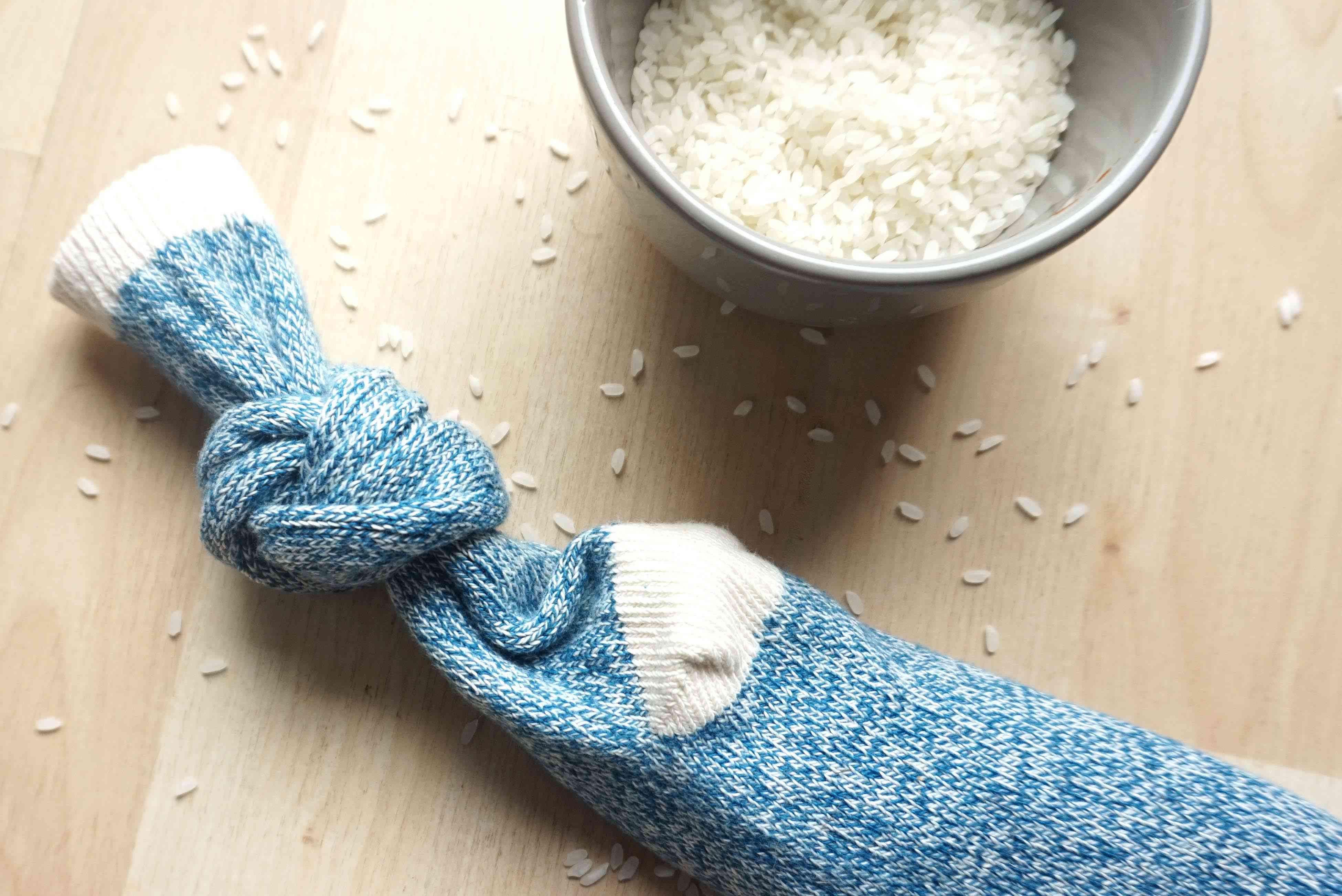 A sock filled with grains of rice and tied closed.