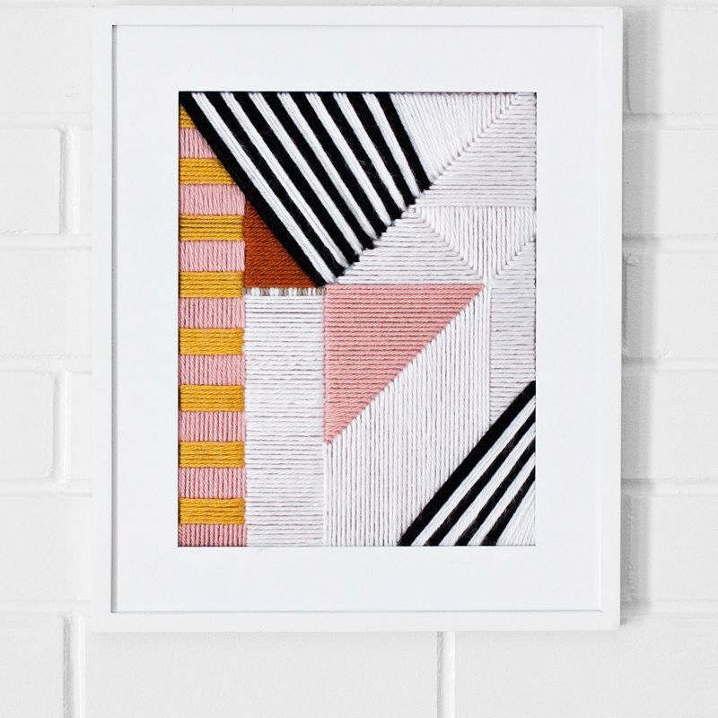 Graphic embroidered geometric wall art.
