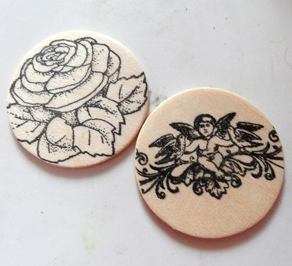 Close up of wooden disks with stamps on them.