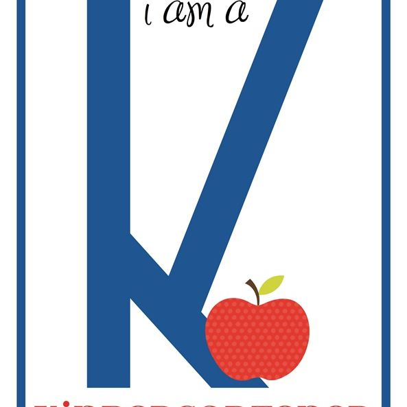 A first day of Kindergarten sign in blue and red.