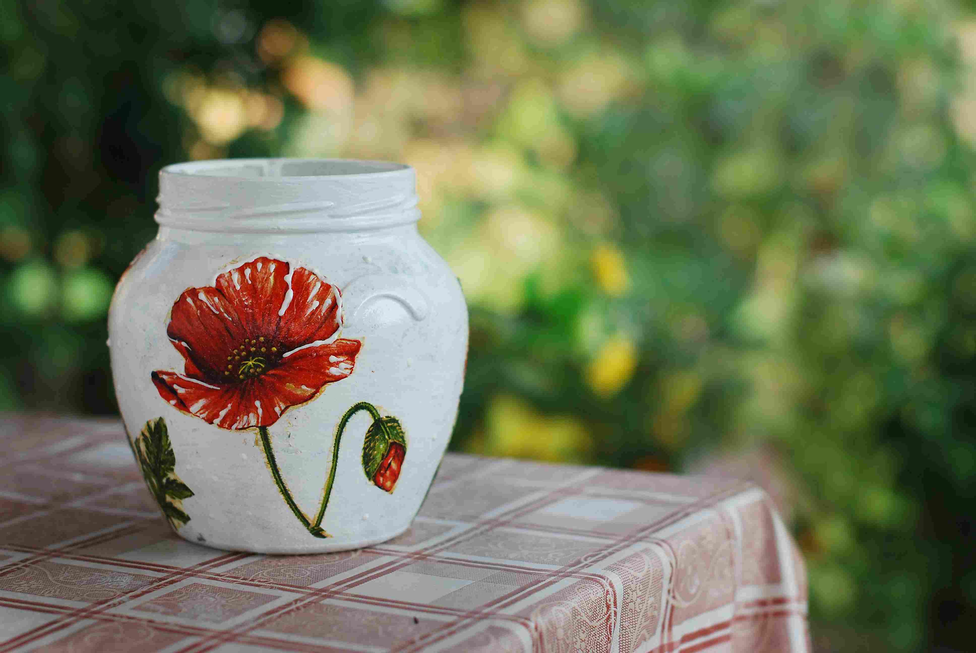 decoupaged poppy flower on jar