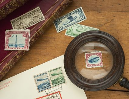 Close up of stamps collection and magnifying glass