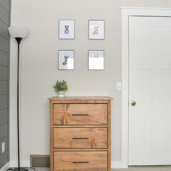 A small dresser in a bedroomj