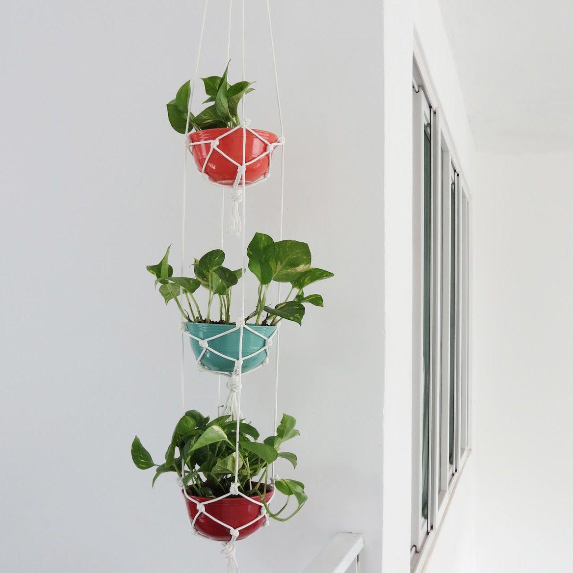 layered plant holder made of macrame
