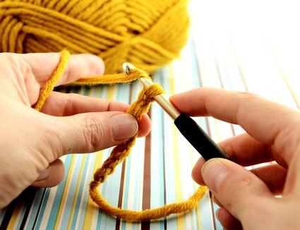 Woman crocheting wool