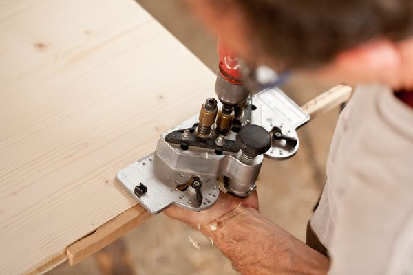 carpenter placing a jig and piercing
