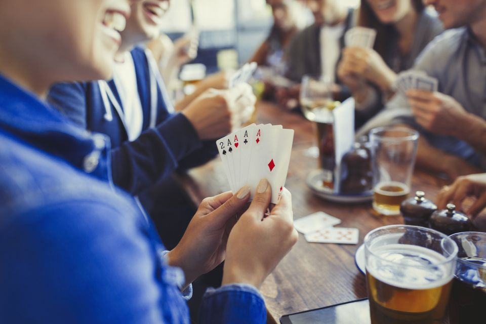 People playing cards at a table.