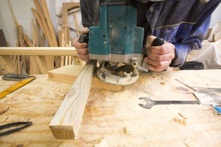 9 free diy router table plans you can use right now a man using a router keyboard keysfo Gallery