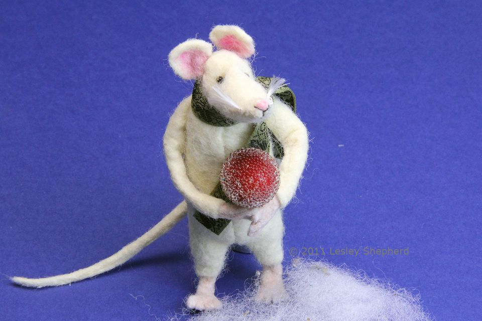 Poseable miniature mouse for a Christmas decoration, made from felt over a wire armature.
