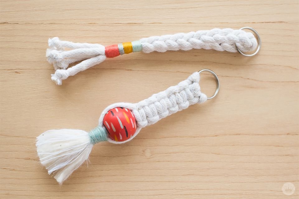 Two macrame key chains laying on a table